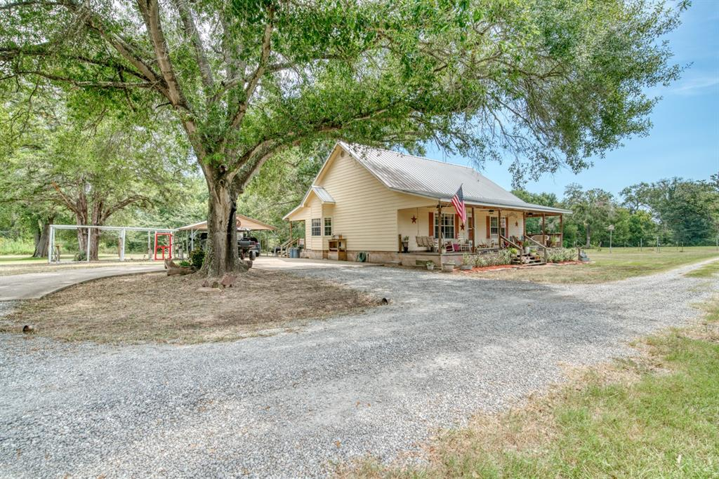 Highly desired country home on 10± acres in Madison county. Custom built home featuring 2 bedrooms, 2 bathrooms as well as a spacious loft. Updates include new granite counter tops in the kitchen and bathrooms as well as granite showers. The kitchen has custom cabinets, island, and a walk in pantry. There is also a 624 sq ft guest cabin that has a full bath and kitchen. 30 x 30 workshop with 2 garage doors for plenty of workshop space.  Property is apx. 40% open and 60% wooded with scatted oak trees, with a pond near the front of the property stocked with catfish. As an added bonus home comes with 22kw home generator. Only 30 minutes from Bryan/ College Station and FM 2289 road frontage.