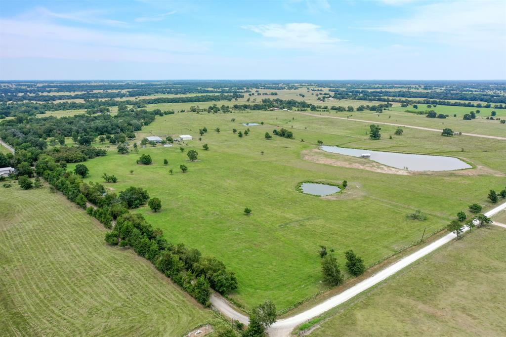 14+/- acres for sale in Madison County.  Property has road frontage on two sides, completely fenced and has a stock tank. There is a great building location above the pond. Electricity is available at the road.
