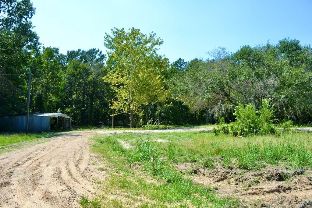 Amazing opportunity to own land not only adjacent to Davy Crockett National Forest, but also directly connected to the famous White Rock Horse Trail! All utilities are in place as well as a Pole Barn.