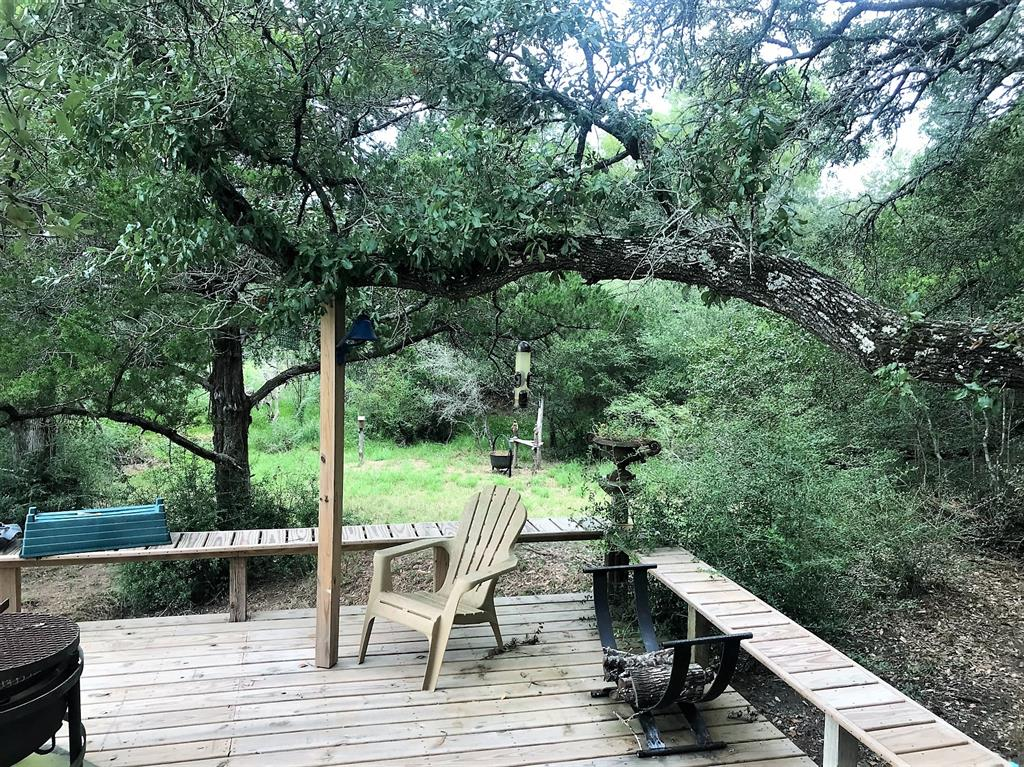 WOW! Purchase your own +/- 51.68 ac. tract in one of the most highly sought after areas of Colorado County. Perfectly located just off Zimmerscheidt Rd & a few minutes from The Falls Country Club & the Big Easy Ranch. This one has it all with a nice mix of heavy woods w/majestic & sprawling live oaks, selectively cleared areas plus open land. What could be better than entertaining on the deck that boasts a nicely appointed kitchenette and a ½ bath, all overlooking a babbling creek. A metal carport also offers an enclosed shed at one end for all your storage needs plus a quaint tool shed! To top it all off, a concrete crossing over the creek was installed.  Lots of home site locations for you to choose from. It is your ticket out of the city, either for weekend or full time living. You will find the peace and quiet you have been looking for here! This area is home to an abundance of animals and birds. Easy 45 minute commute to Katy, TX. May carry Columbus address. Drone footage coming!