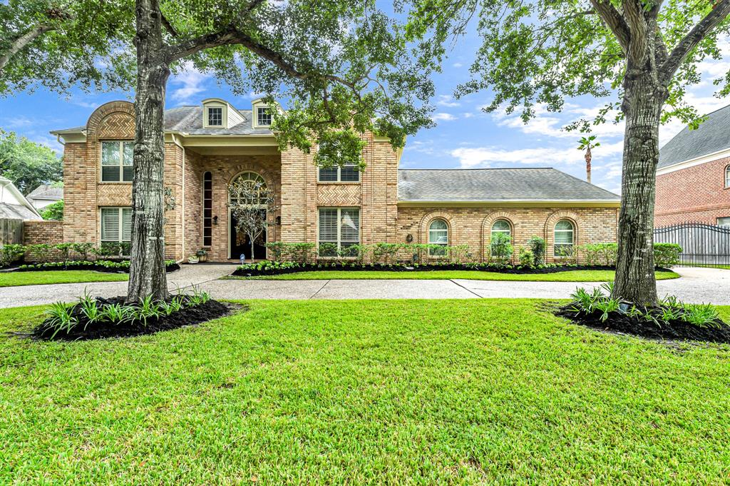 This stunning remodeled home features an upscale epicurean kitchen with Quartz countertops and plenty of storage. Three master retreat level bedrooms, up to 6 bedrooms total and 6 high end designer bathrooms highlight this incredible family retreat. A guest suite highlights the garage. This wonderful home sits on 1.5 lots and features a large auto court or gated play area for the kids. Upgrades include iron entry doors, shower remodels, full bath upgrades, designer kitchen remodel and much more! Come visit today and stay a lifetime! Home is magazine worthy!
