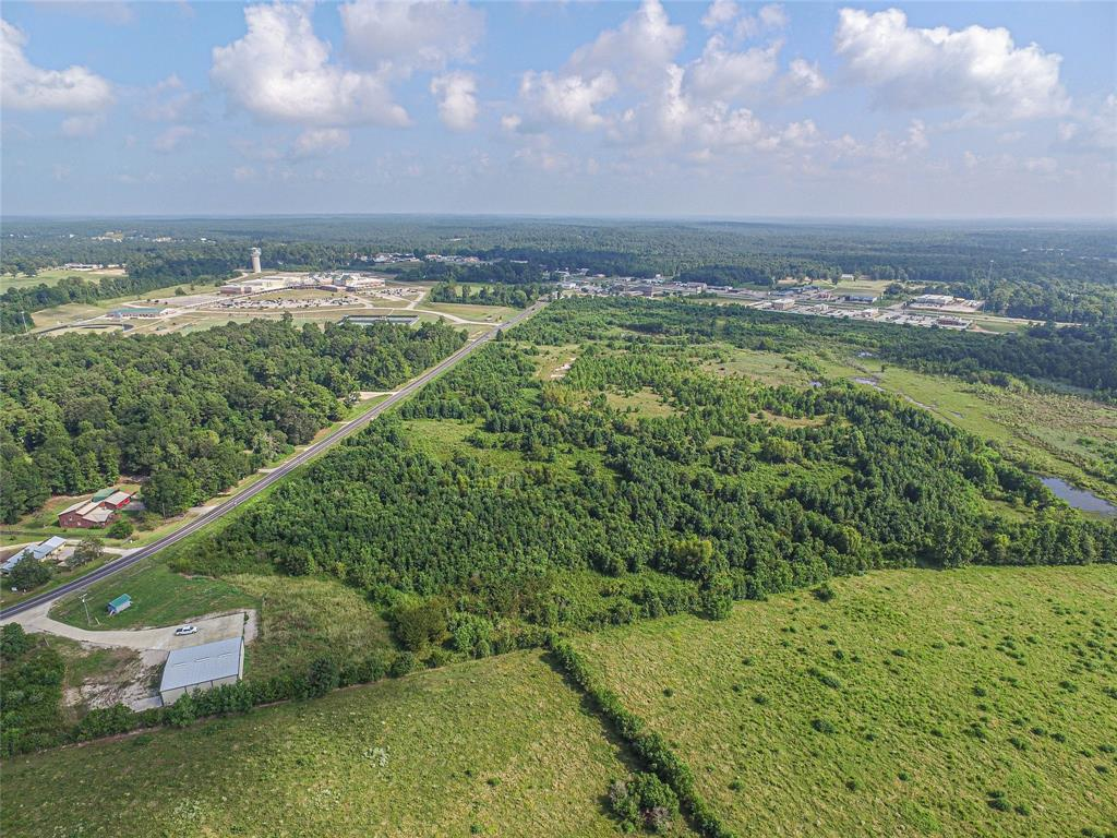"""Approx. 880"""" of FM 350 frontage located just south and across from the Livingston High School. 36 acres partially in the city limits of Livingston. Located next to a fire station, across from the High School. Near shopping. Lake Livingston just a few miles down FM 350."""