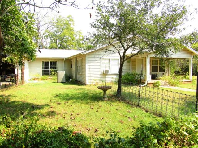 Almost 15 acres of land located 15 miles West of Crockett on FM 1280 in Austonio. This property features a vinyl siding house with 4 bedrooms 3 full baths, 2 living areas, office space along with a 90% completed addition onto an older home that will give you a total of 2,800 square feet of heating and cooling. You will find 2 central air and heat units along with 2 water heaters and great closet space throughout. Outside you will enjoy the 14.95 +/- acres that has great mature trees along with a pond and 3 outbuildings and barns. The seller of this property is retaining a life estate with the house and barns, but the buyer could immediately enjoy the 12 +/- acres of land to either build a new home or for recreational purposes. Call us to see this property today!