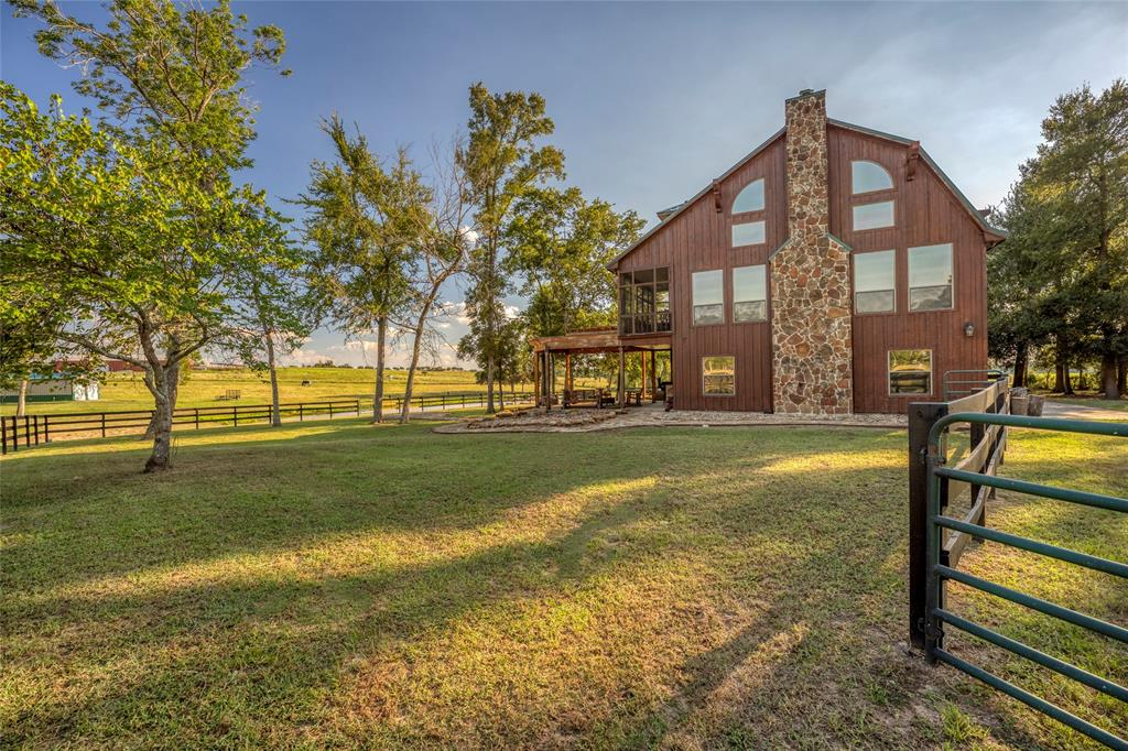 Serene country beauty in the highly sought after Ranches of Doe Run community!  Approximately 15.913 acres featuring a 3 story custom built cedar home.  The home features 2,896 square feet with 3 bedrooms, 3 bathrooms, 2 car garage, open floor plan, wood flooring, granite kitchen countertops and a soaring vaulted ceiling with a stone fireplace.  Each bedroom and bathroom is on a different floor allowing privacy for you, your family and guest.  The main living is on the second floor with double French doors leading out to a screened covered balcony overlooking the pond and property. Outside you will enjoy the expansive patio perfect for entertaining, a barn for your equipment/ATV's and plenty of trees and wildlife.  This property is AG exempted to keep the taxes low.  In addition, Doe Run property owners have access to 16 acres with trails and Brazos River beach. Sit back, relax and enjoy the country life!