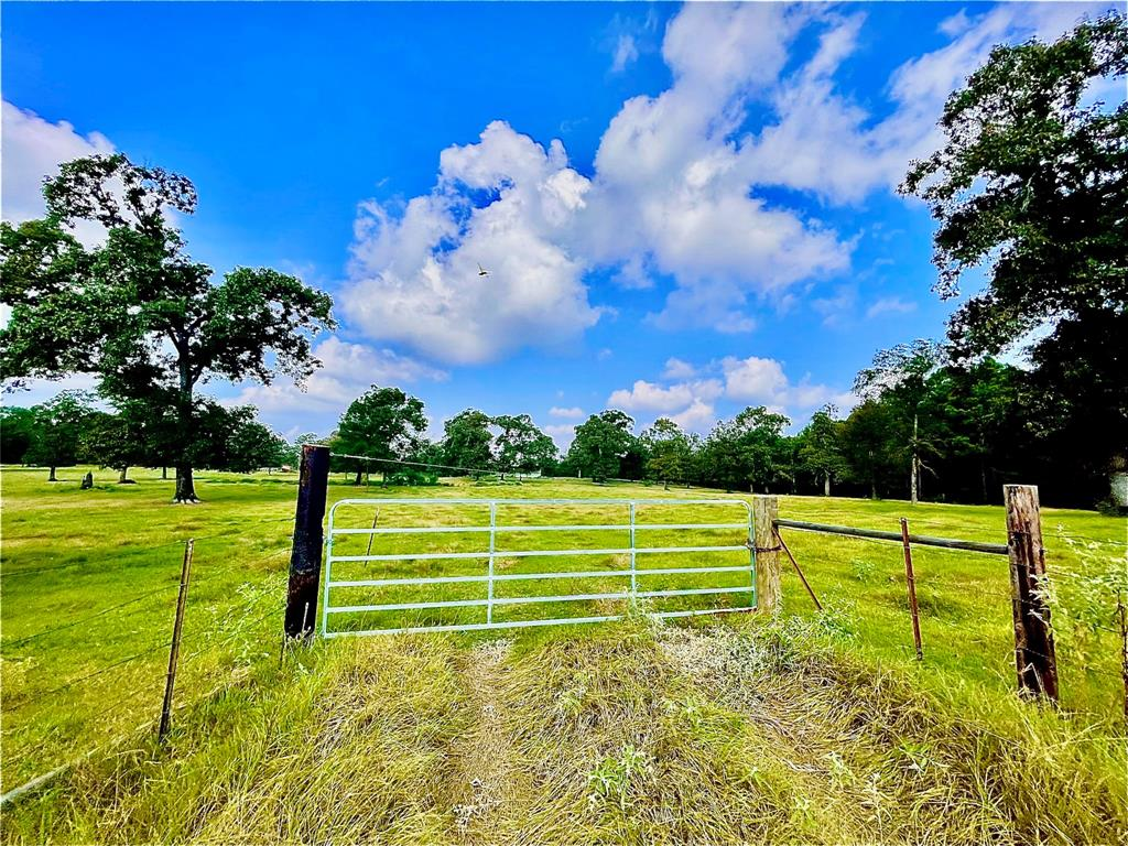 The acreage you have been waiting for all this time. This unrestricted 22+ac. could be yours today, so wait no more. Property has plenty of room to do whatever you desire. If you're wanting to build a house or bring in a mobile, to even making it an RV Park, you can. Property is waterfront to the Trinity River you can canoe or take a small watercraft down the channel & end up in Lake Livingston within minutes. So no need to pay for that boat storage any longer when this is yours. The large strip of the river makes a great campsite. You also have large stones that been placed years ago somehow, that gives it a great visual appeal like no other. If you are a hunter you will love the rolling hills, as it has three sections that layer perfectly, so unique. Speaking unique the hunting lodge is custom built, to be the perfect getaway retreat. Totally cozy & minimum utility cost if any, as it can be ran on battery & even makes it own water source from the rain. Time to call this one yours.