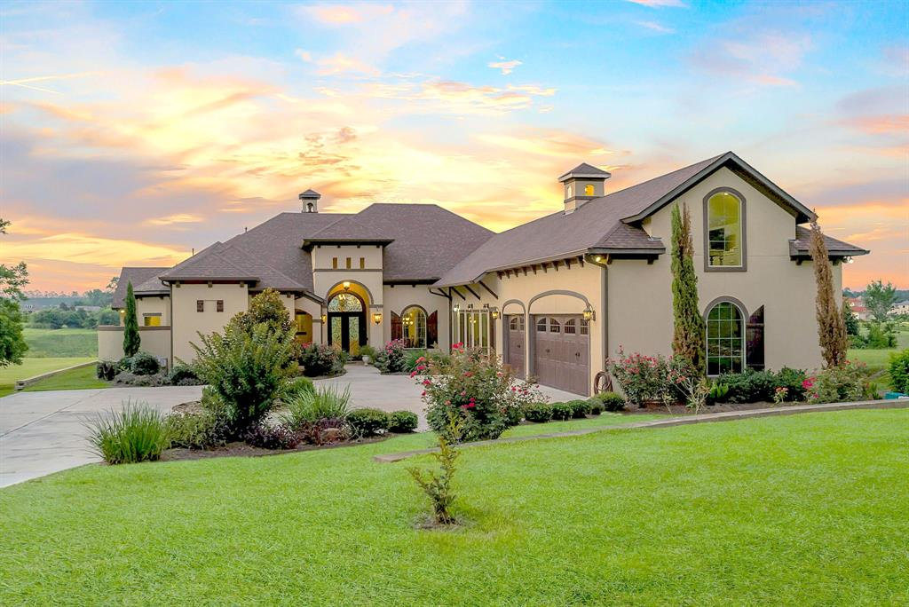 Impeccable custom home on over an acre in the gated Harbor Side subdivision. Circle driveway welcomes you to the entry featuring soaring ceilings & open floor plan with views of the fantastic backyard in every room! Chef's kitchen with brkfst bar, granite counters, 2 sinks (1 in island), pot filler, 3 ovens (2 Viking & 1 Wolf), built-in SubZero fridge/Thermador coffee maker & huge butler's pantry lined in cabinetry w/counters. Wet bar & wine grotto w/separate ice maker, beverage & wine fridge. Spacious master quarters w/heated airjet tub & walk through shower. Secondary bedrooms all w/bathrooms & walk-in closets. 4th bed perfect for guests/in-law suite with it's own door to outside for privacy. Stroll upstairs to the extra room perfect for crafting or possible game room. Enjoy the extended outdoor covered patio w/3 sitting areas, fireplace & summer kitchen overlooking the peaceful backyard. Equipped w/storage space in every nook & tons of designer details, this home is one-of-a-kind!