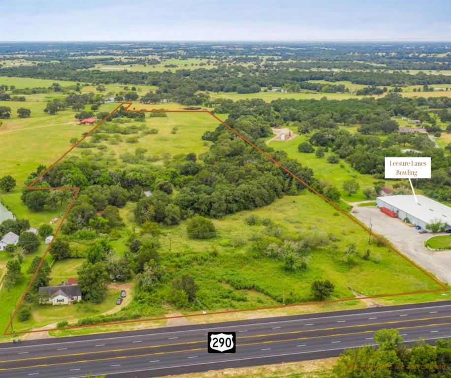 Enjoy the best of all worlds with this 24.99 AC property located outside city limits off Hwy 290! Parts of the property are zoned commercial, parts residential, and the rest farm and ranch, allowing for plenty of options for how to take advantage of the land. Three entrances off of 290 provide a great start for commercial development, a home that could serve as a personal residence or income-producing rental, an Ag Exemption is in place for those looking for agricultural property, and county water and Bluebonnet electricity are available to serve any usage.