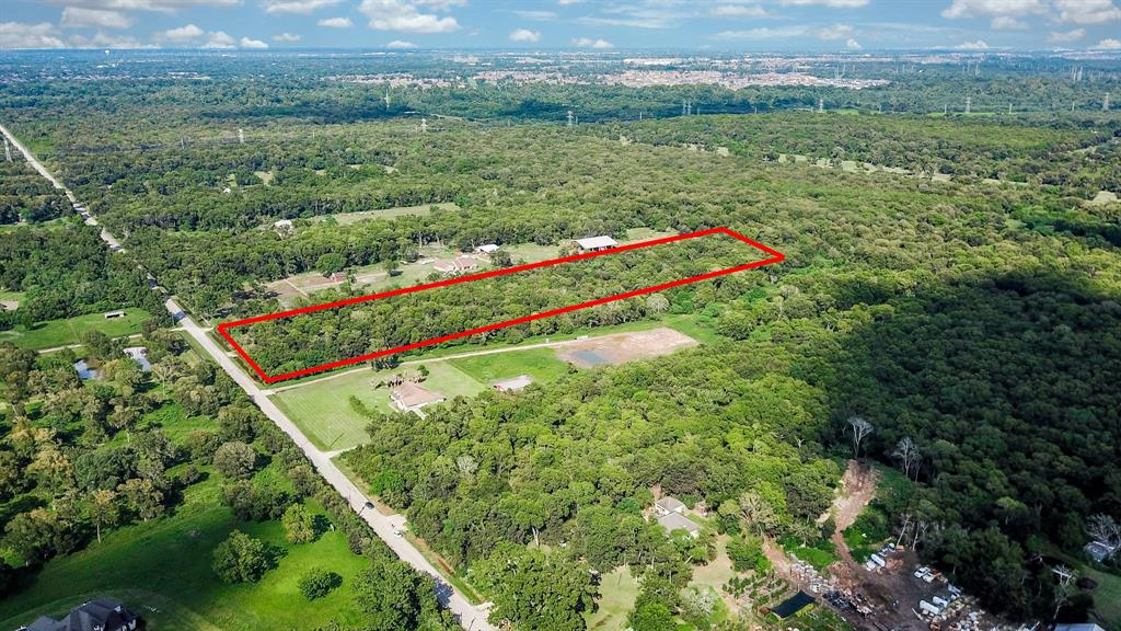 Wooded 10 acres of undeveloped land in Richmond near Booth. Leaves you with a great opportunity to build the perfect home zoned to excellent rated schools and still very accessible to nearby shopping centers and major highways to make the commute easier.
