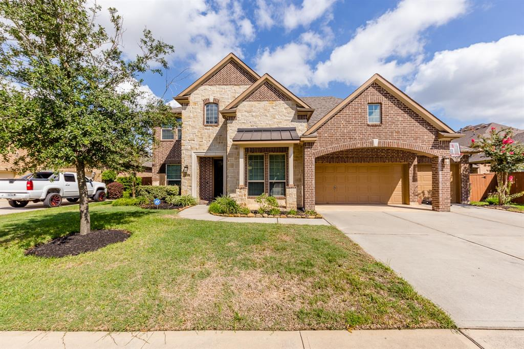 Gracing an oversized lot, this LIKE-NEW home shines with designer features throughout. Built in 2018, this home has been meticulously maintained and delivers an appealing floor plan with 4 beds, 3.5 bath, and 3 car garage, a study/office, and a media room. Downstairs you will find a formal dining room, and a spacious family room with a wall of windows that welcome in a ton of natural light. Open to the family room are the breakfast room and the gourmet kitchen with double oven. First-floor master bedroom with en-suite bathroom and three additional generous-sized bedrooms on the second floor, along with a spacious media room. HUGE backyard with covered patio and plenty of space for gardening, a playscape or to build a pool! Located directly across the street from the neighborhood fishing pier and access to waterfront leading to Lake Houston. The community has first class amenities such as a recreation center, resort-style pool, spray park, and miles of walking and biking trails.