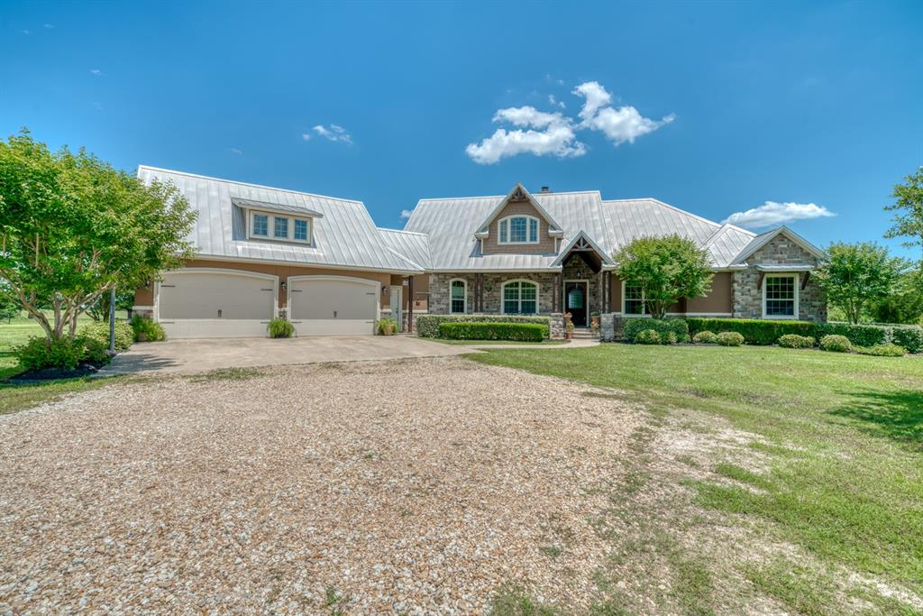 15 acres of improved pasture with beautiful home within 15 minutes from College Station. This 3,043 sq ft home is breath taking with granite counter tops, new hardwood flooring and cabinets. Enjoy the over-sized 2 car garage, with plenty of space for a workshop. This 5 bed 3 bath home offers plenty of space for the entire family to relax. Enjoy a nice evening on the back porch which is shaded by an elevated roof as well as an outdoor ceiling fan. This property also includes a 30'x40' barn with horse stalls and cattle working pens. The barn has a 15' & 20' overhang as well as (2) 50 amp electrical hookups, there is also a 50 amp electrical hookup near the home.