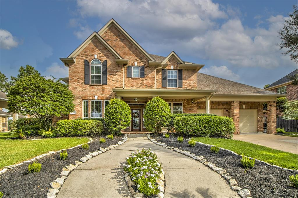 Stunning 5-bedroom 3.5-bathroom former model home in sought after Spring Creek Oaks.  Zoned to award winning Klein High and Klein ISD!  Grand entrance boasts formal dining room and stately office.  Spacious 2-story open living space with stone fireplace, wood floors and wrought iron spiral staircase.  Wall of windows offers full view of outdoor pool & patio.  Kitchen is open to living room and features granite countertops, large walk-in pantry, plentiful cabinets and counter space.  Bonus sunroom ideal for pets, workout area, or music space.  Generous primary bedroom with bay window area, along with en suite bath. Three of four oversized secondary bedrooms include walk-in closets. New carpeting throughout second floor.  Beautiful backyard oasis features sparkling pool with waterfall, luscious landscaping and cozy fire pit area (no back neighbors).  Rear fence gate provides quick access to tennis courts, soccer and baseball practice fields.  The 3rd car bay is converted into a workshop.
