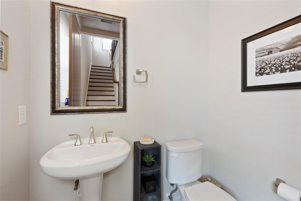 The half bath is located conveniently off the main living floor.