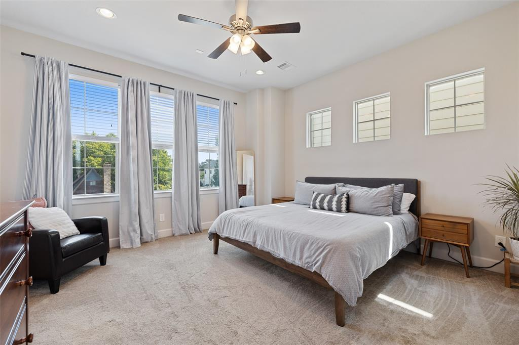 This spacious primary suite can easily accommodate a king size bed and has a lot of great lighting.