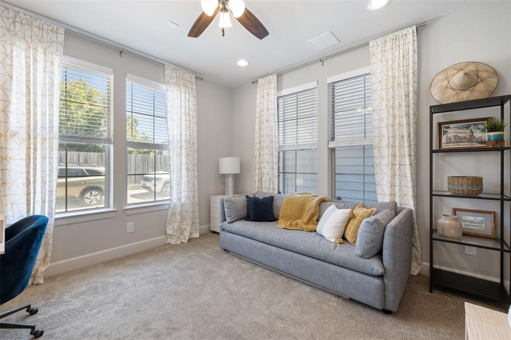 This multi-functional downstairs bedroom can serve as a guest bedroom, workout room, or home office.