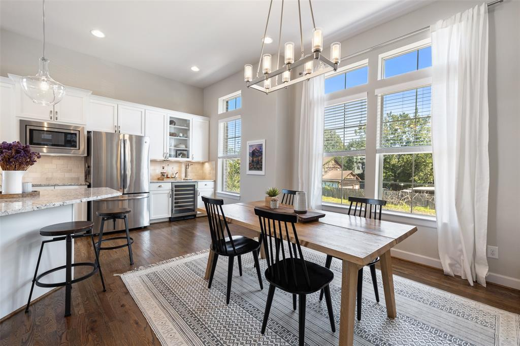 The dining room space provides plenty of room for a large dining room table.