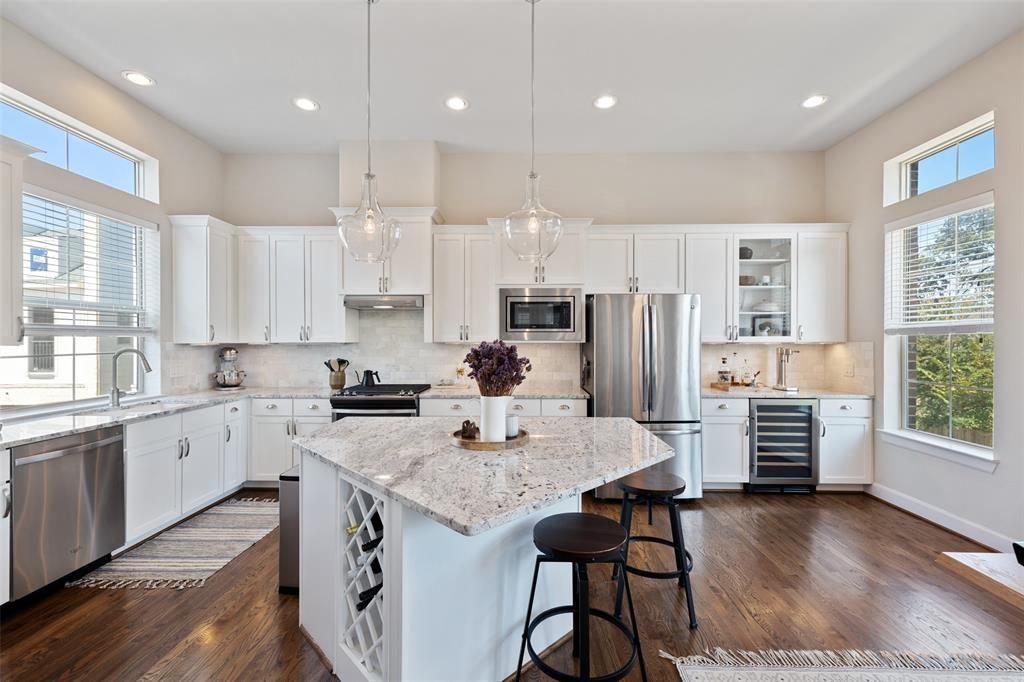 The large kitchen has tons of kitchen cabinetry and counterspace. it also has a great dry bar area with a built-in beverage fridge and extra storage. You will also find under cabinet lighting.
