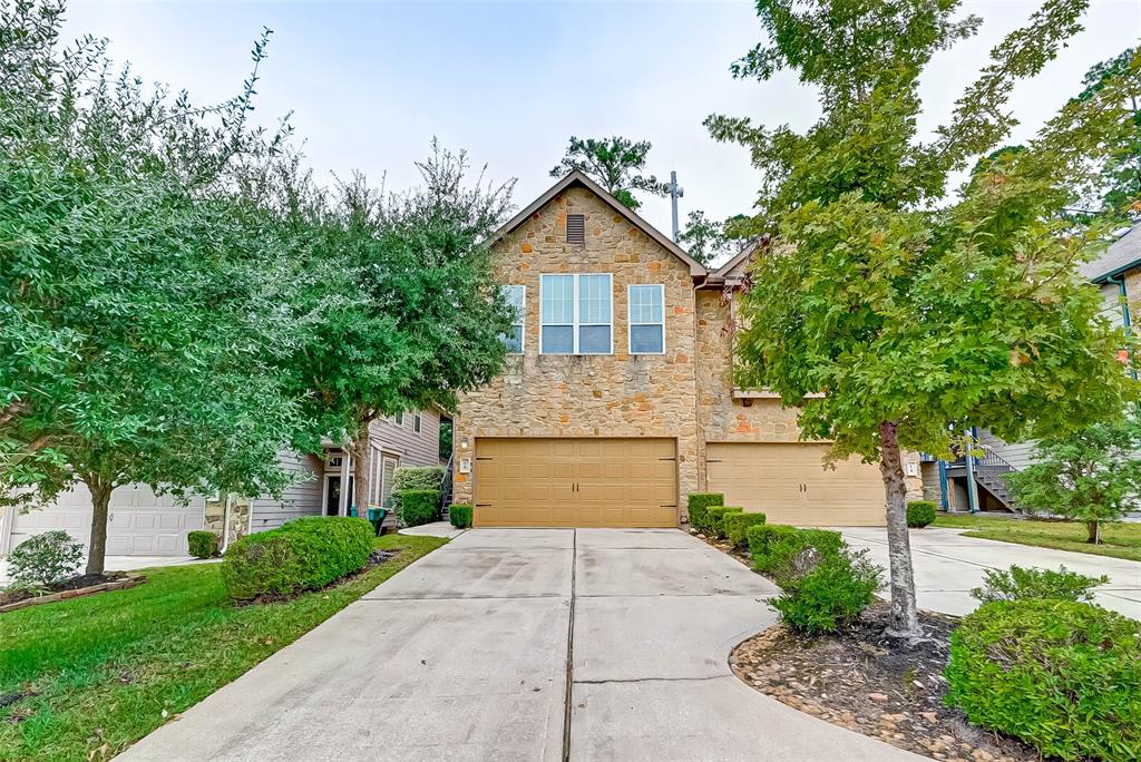 """**CONROE ISD SCHOOLS**TOWNHOUSE**GREENBELT**SPLIT PLAN**WALK/BIKE TO ELEMENTARY & 9TH GRADE CAMPUS**Beatiful townhome in highly desirable Cheswood Manor. """"Bungalo"""" open floor plan with gameroom/flex room up.  Granite island kitchen with stainless steel appliances, tumbled backsplash, under cabinet lighting, and ceramic tile flooring.  Three bedrooms or two bedrooms and study.  Walking distance to park and YMCA, library and shopping.  Easy commute to I-45, The Woodlands Mall, Pavilion and abundance of entertainment and dining.  BACKS UP TO RESERVE!"""