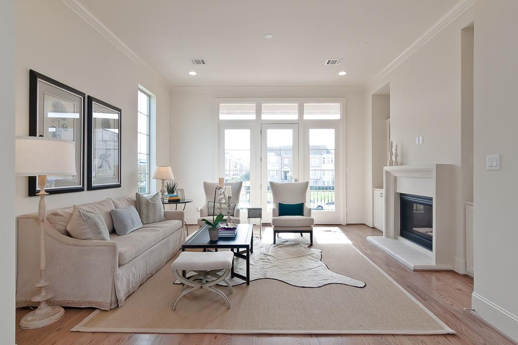Light Cascades Into The Living Room Through The Window And The 9 Foot Wide  Patio Doors. A Cast Stone Fireplace With Built In Bookshelves Are The Focal  Point ...