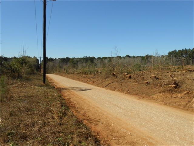 Located on Pipeline road or CR 2125 about 5 miles from Houston County Lake.  This property has rolling hills with elevated changes. Property has over 800 foot of road frontage. This property also has a creek with utilities available with an additional 17 acres available across the road. Call us to see this property today!