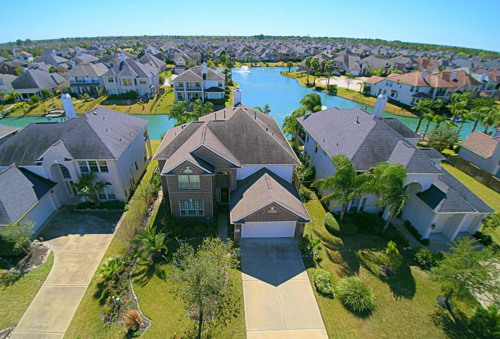 a Cypress, Texas suburban neighborhood shot from an aerial view by a beautiful pond