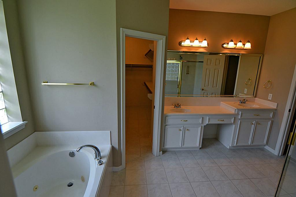 Fairway Meadow Ln Spring TX - High low bathroom vanity