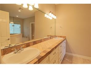 The master features a double sinks, jetted tub and walk-in shower. Notice the water closet back on the right.