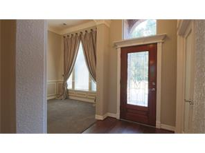 The front entry features a leaded glass door with a  beautiful crown molding enclosure.