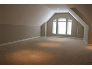 There is a second floor  bonus room great as a media room or craft space.
