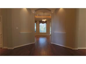 Once in the foyer, the eyes follow the expansive wood floors, tall ceilings, art niches and arch way. You can see straight to the back yard.
