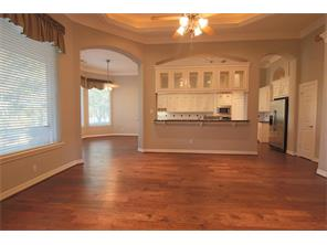 From the other side of the family room, this is your view to the breakfast area and kitchen.